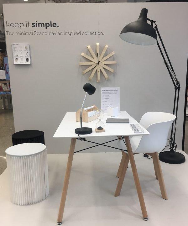 white desk, white chair, black floor lamp, black desk lamp, wall clock