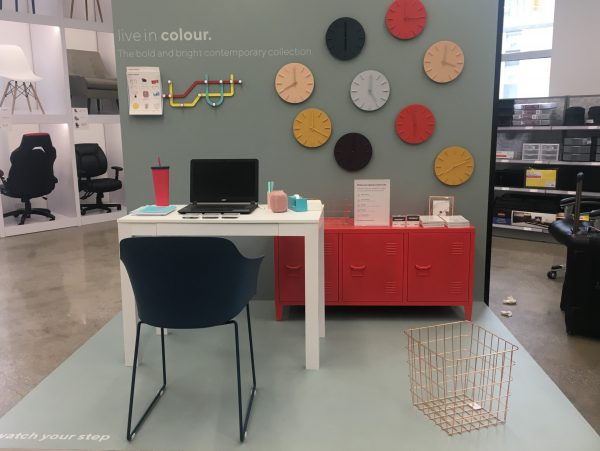 white desk, black chair, coral office storage, wall clocks, umbra hook