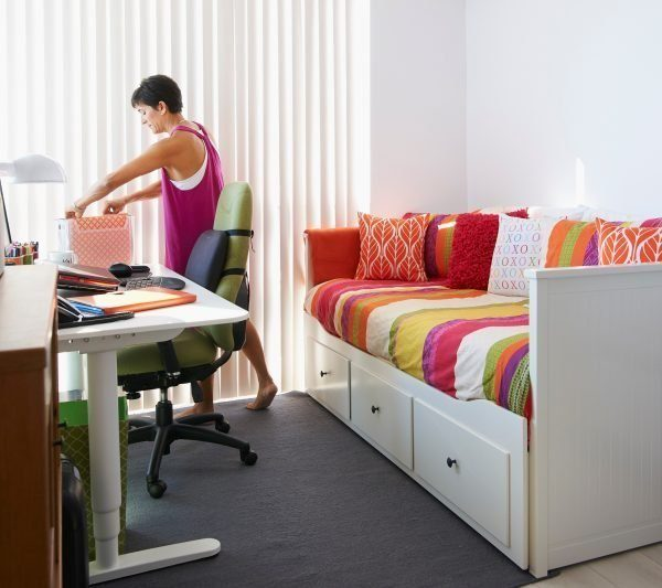 Clare Kumar at desk in tidy organized home office