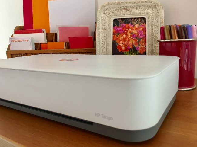 sleek white printer on top of cabinet