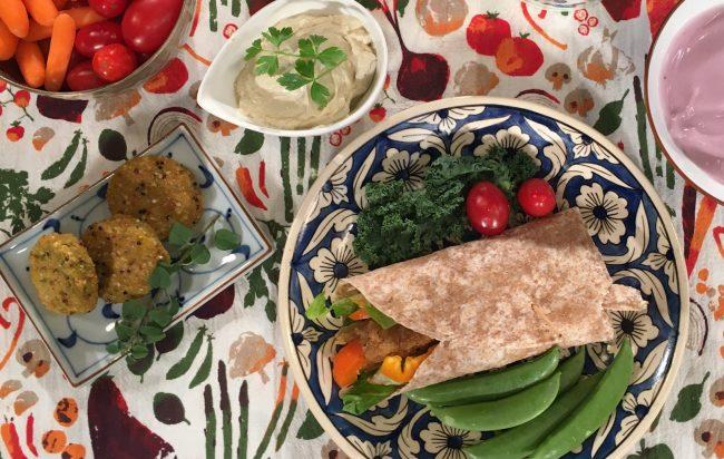 Variety of food on a tea towel with vegetable print