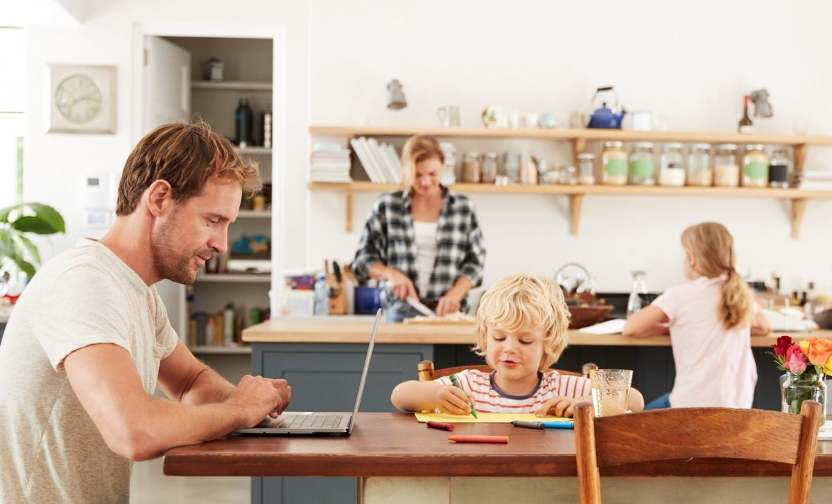 Young white family busy working in their kitchen