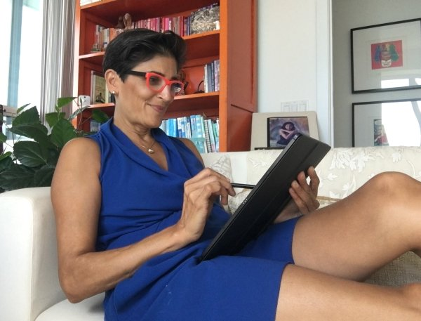 Reclining on a sofa using a tablet